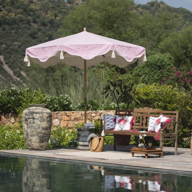 Pink Aretha Octagonal Parasol lifestyle image of parasol by the pool