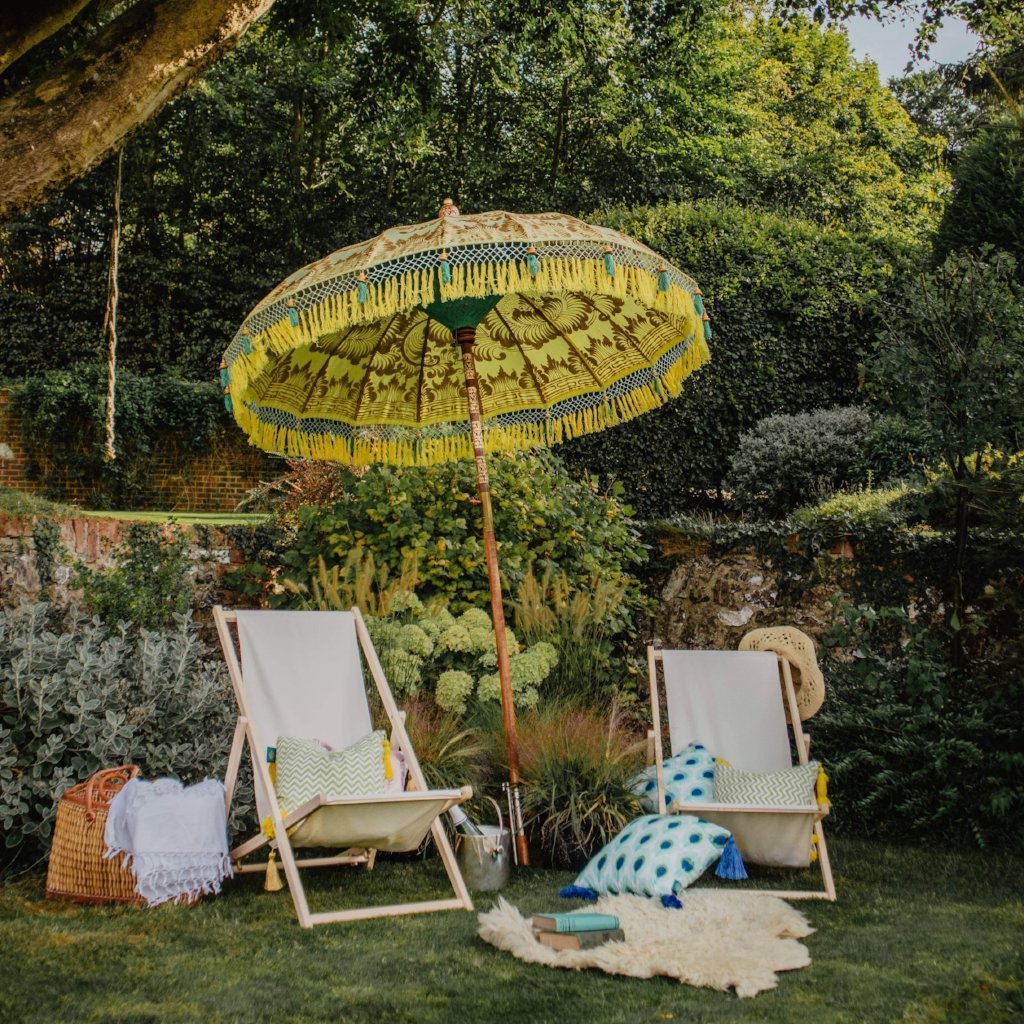 East London Parasol Company Bali Bamboo 2m garden umbrella. Goldie- yellow and gold with tassels. Handmade and handpainted with yellow and green fringing.