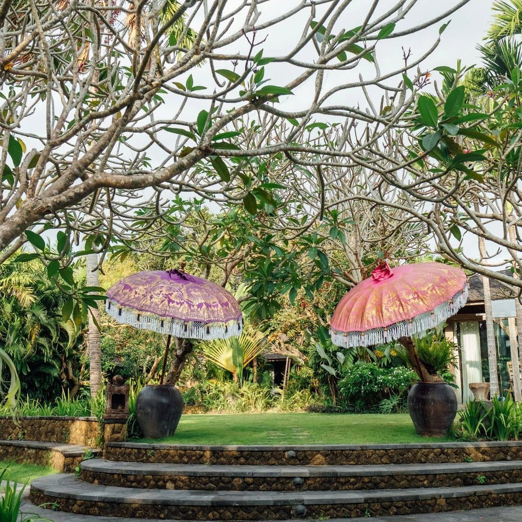 East London Parasol Heidi-  pink and gold bamboo 2m Bali garden umbrella. Tassels in shades of white and pink, hand made and artisan. The perfect decorative umbrella for picnics, summer, patios, pool side and terraces. Colourful, pretty and luxurious designer garden feature and perfect for a colourful summer party.