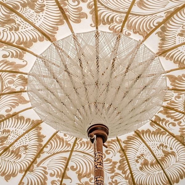 Simone Bamboo Parasol Product shot - White canopy with gold hand painted lotus design, and white tassles