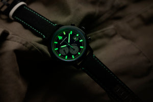 black and green dial chronograph watch with cordura strap lume