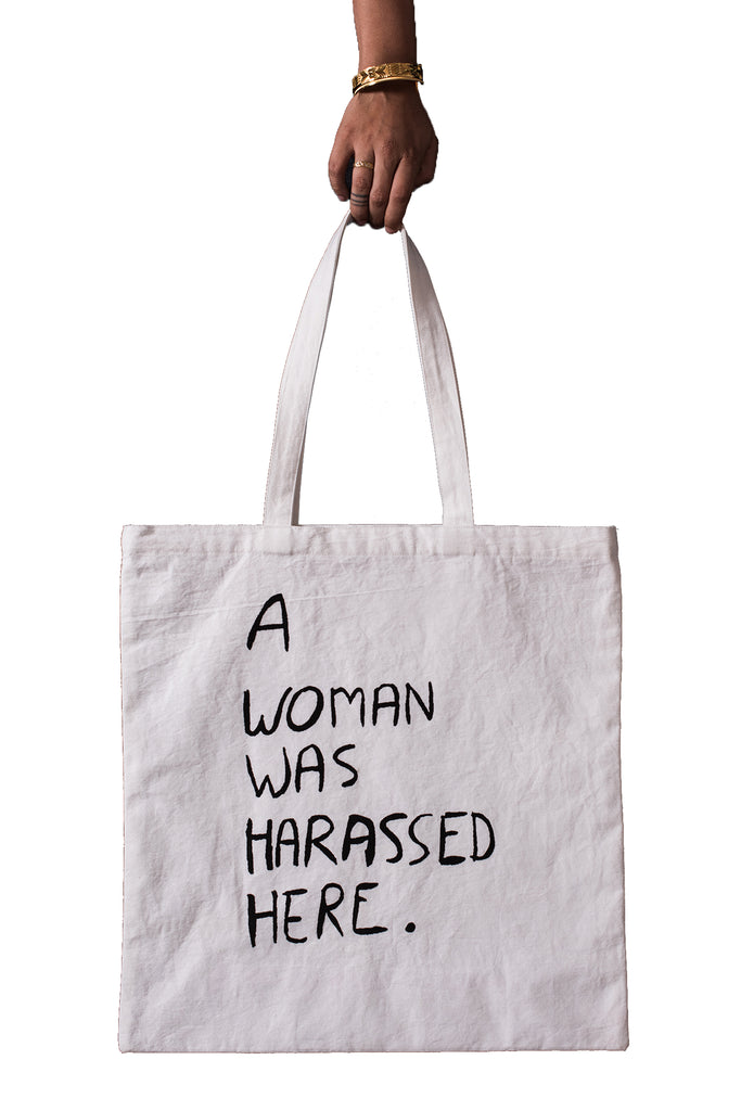 A WOMAN WAS HARASSED HERE TOTE BAG - ENGLISH