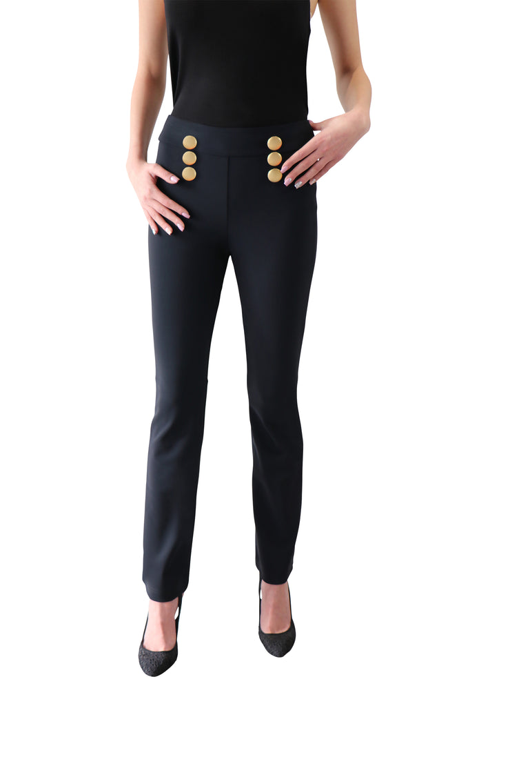 Candle fit black trousers for women viewed from the front showing the legs of a women with black shoes.