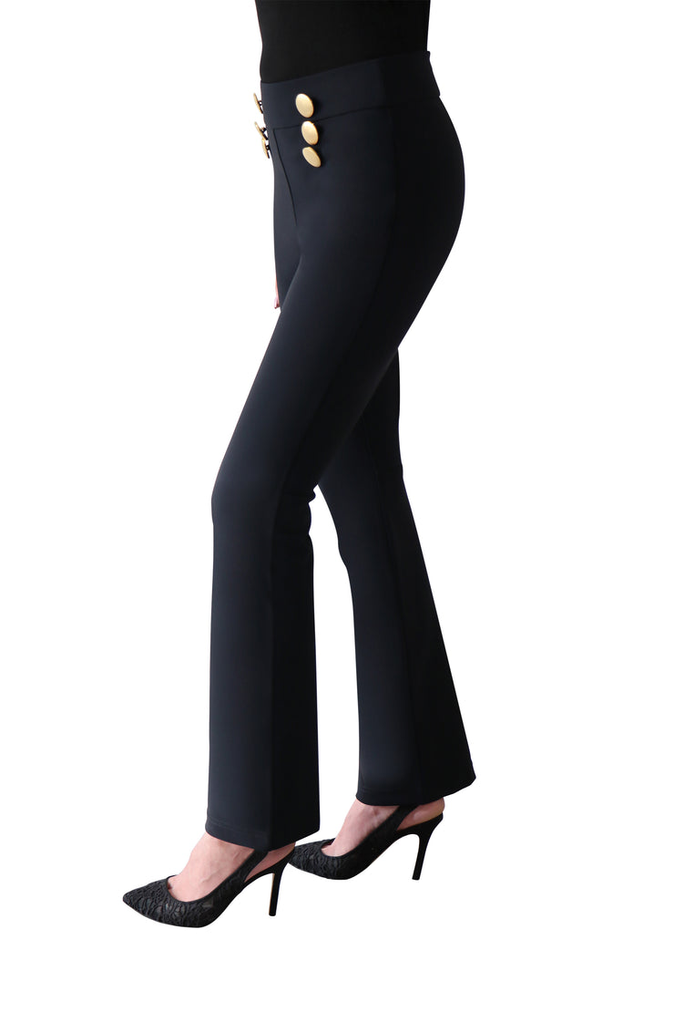 ladies legs from the waist down showing off the candle black trousers .