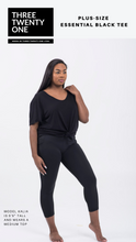 Cargar imagen en el visor de la galería, Plus-size black t-shirt  (Comes in sizes 1XL, 2XL, 3XL) • Front tie detail • High-low hem • Versatile & comfortable • Lightweight & breathable  Fabric: 100% Rayon