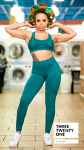 "Load image into Gallery viewer, A Gem. (Sold in ""one size"" and fits a size 0 to 12-14) • Seamless, high-waisted, 7/8 cut leggings • Super stretchy, luxurious feel • Smooth fit, vintage wash • Racer-back style top, double-layered (no padding) •Includes both pieces. Made in USA  Edit alt text"