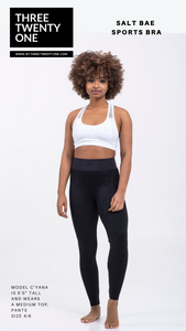 "White racer-style top (Sold in ""one size"" and fits a size S to L)  Signature racer bralette with peephole detail • Ultra Soft • Trendy and versatile style. Great alone or layered • Seamless • 4-way stretch • Double layered, no padding."