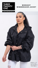 "Load image into Gallery viewer, Shop: Black windbreaker jacket. Throw it on and go. Super stylish, lightweight and chic. Jacket is ""one size"". Typically fits up to a large. • Hoodie with drawstring closure • Mesh lining • Long silhouette • Four pockets with flaps • Adjustable waist and wrists Fabric: 100% nylon"