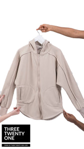 Tan hoodie jacket. Comes in sizes S/M and M/L • Zips up • Longline silhouette • Front pockets • Hoodie  • Soft and cozy