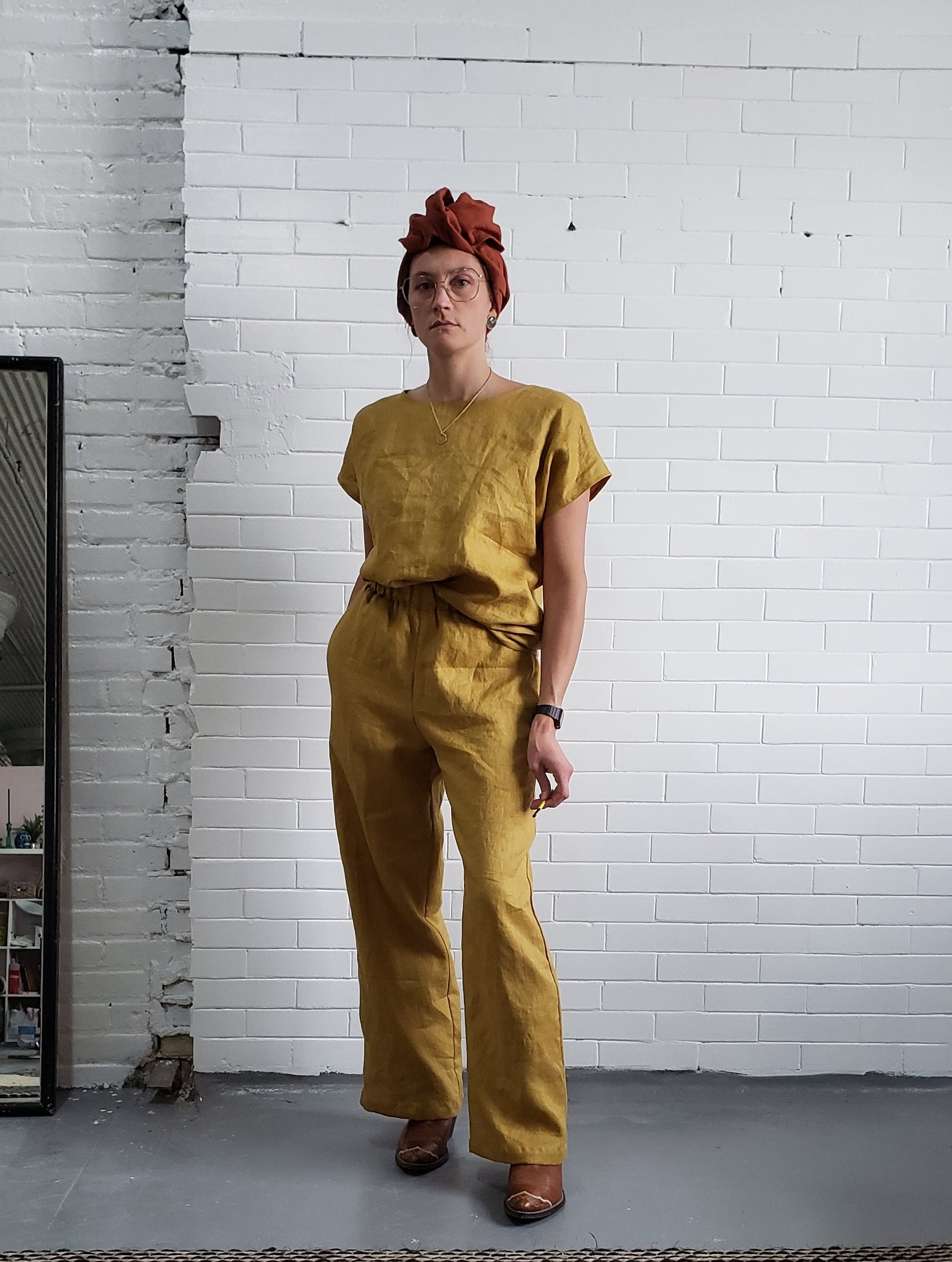 woman wearing golden yellow linen outfit
