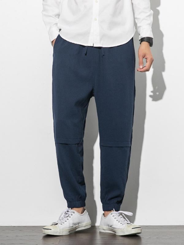 Men Solid Tapered Casual Pants