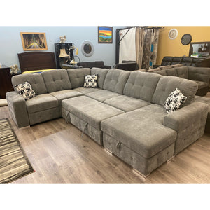 Caramon 4- Piece Sectional with Pullout Bed and Hidden Storage