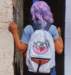 Girl wearing flower backpack outside