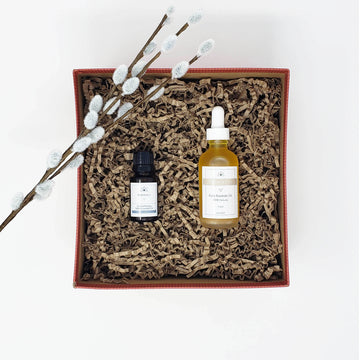 A gift box with a facial oil and a 15 ml Essential oil