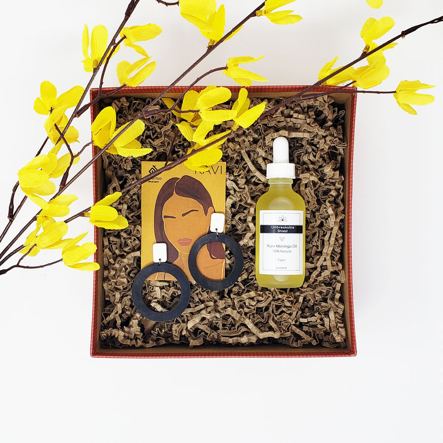 gift box with a Statement earring and a facial oil