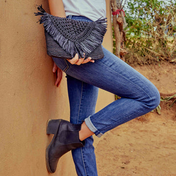 Handwoven Raffia clutch in the color black