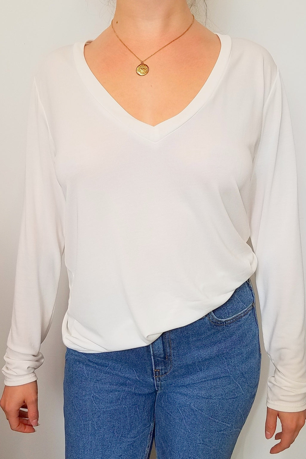 LAST CALL SIZE L | Long Sleeve V-Neck Top in Ivory