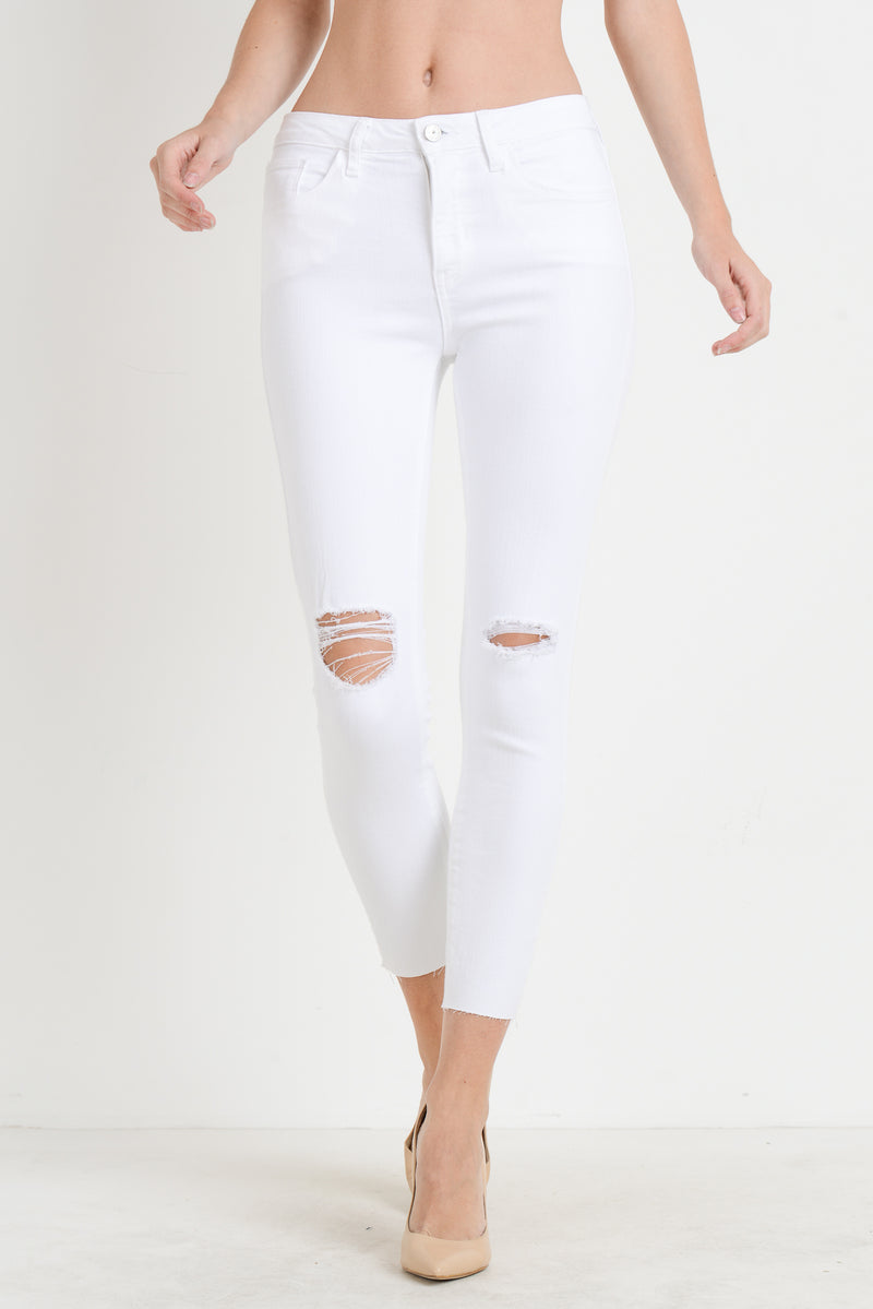 Cropped White Skinny Jeans with Distressed Knees and Hem