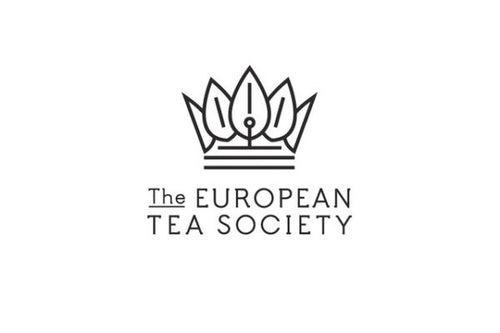 This is the logo of The European Tea Society, of which Mackenzie Bailey is a member. The logo is crown, the top parts protruding from the crown are tea leaves. The name of the organization is written below the crown.