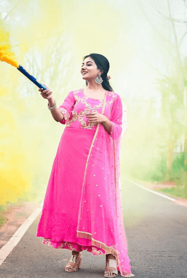 Suchitara adding colors to life in our Rani Pink Suit.