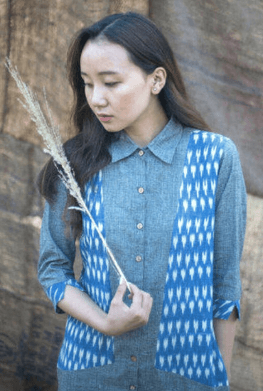 Yeshi donning our super comfortable and chic shirt dress crafted in handwoven cotton and ikat. The dress has pockets.