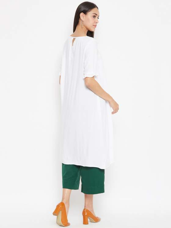 A peek-a-boo detailing on the back neck of the white a line kurta