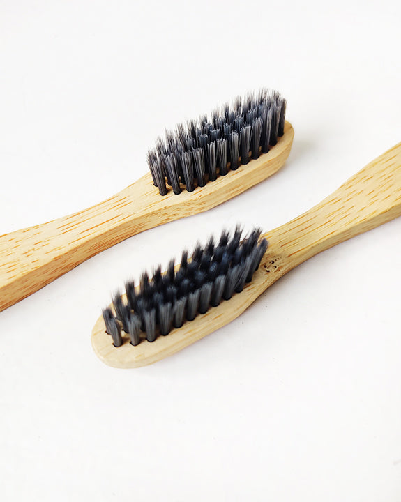 Charcoal bristles in a bamboo toothbrush
