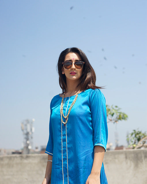 Go for this amazing Silk kurta dress.