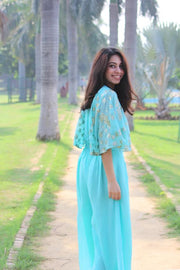 Find this trendy aqua jumpsuit at thesvaya