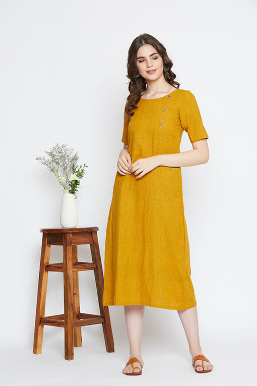 A mustard yellow shift dress for women in handloom cotton