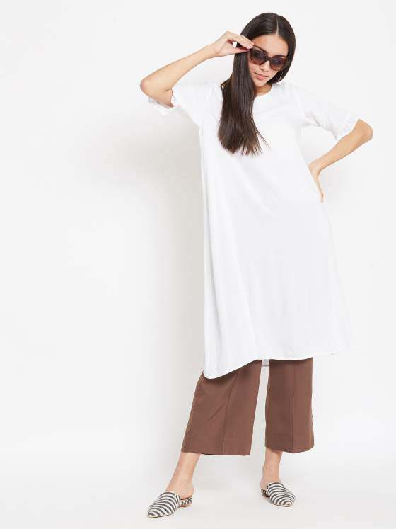 A white aline kurta and a pair of brown bottoms for women