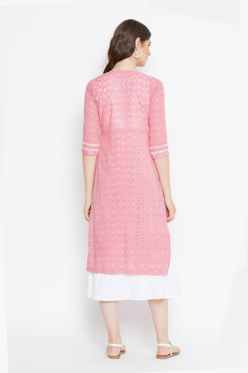 A cotton pink and white kurta and dress combination