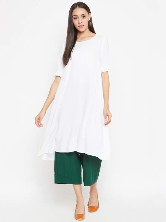 A white aline kurta with a soft boat neck and light frills along the hem of the sleeve