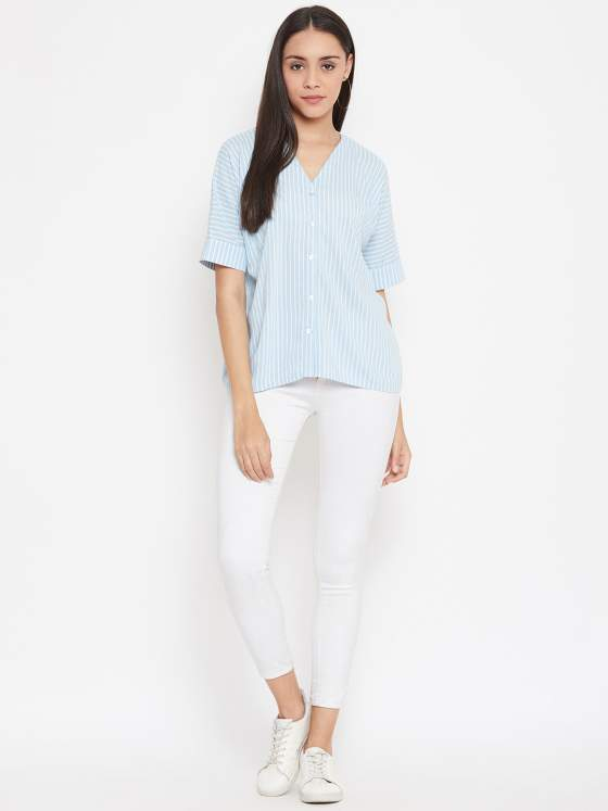 Pair this comfy blue and white striped shirt with shorts, pants, culottes - literally anything!