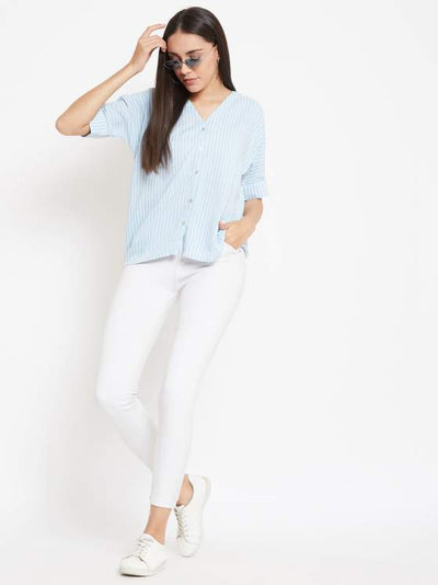 A vertical pastel blue striped shirt for women