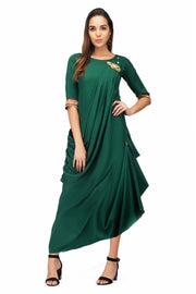 Green draped tunic for women who seek a little extra in their outfits