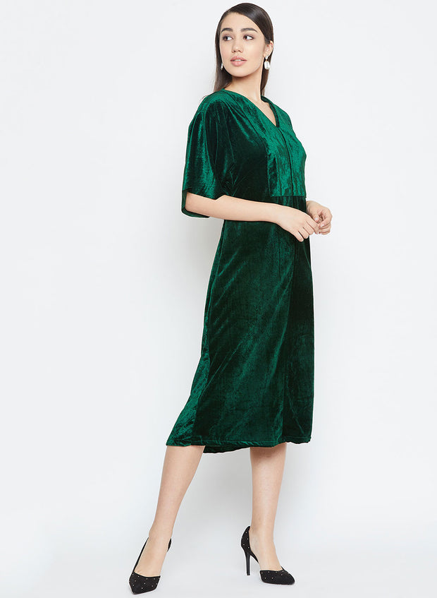 Women's winter dress in dark green velvet