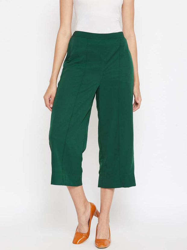A pin tucked detailing right in the center of a bright green cropped palazzo fo women.