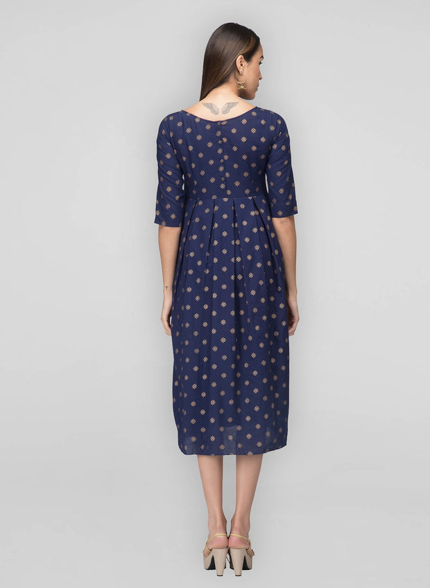 Back button detailing, boat neck, box pleats, and Indian print - east meets west in our navy box pleat dress
