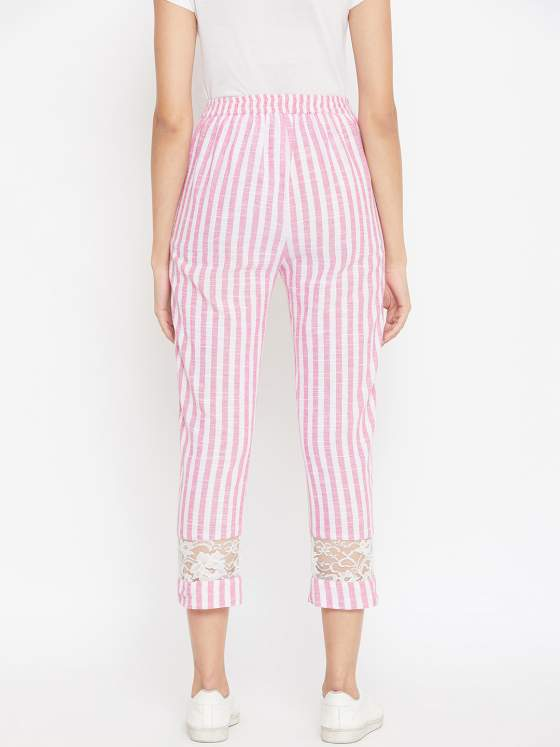 This cotton striped pant comes with a belt in the front & an elasticated waist in the back