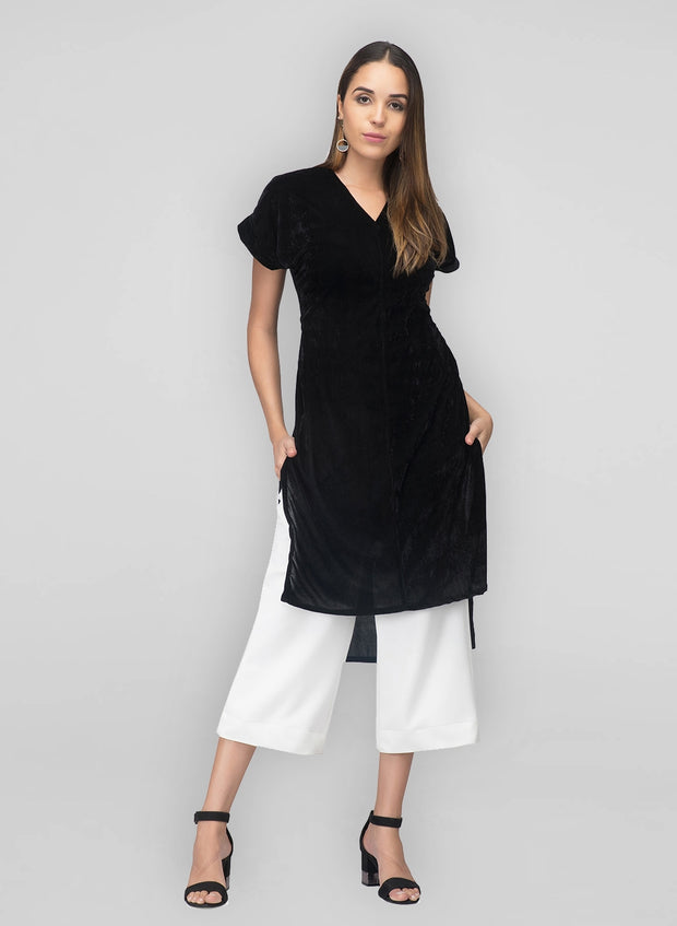 Black kurta in velvet with a high low cut.