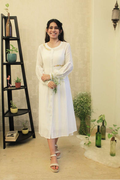 A floral embroidered white cotton silk dress