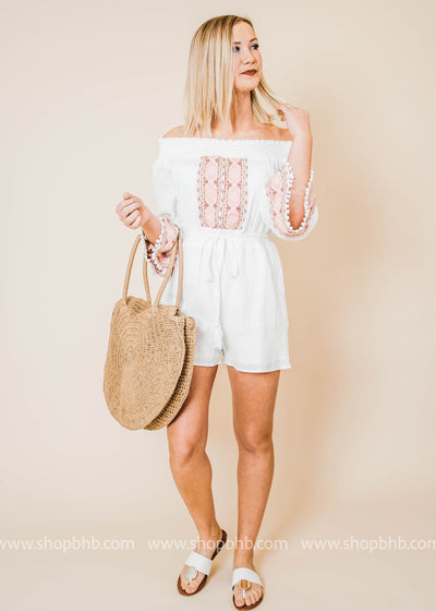 This white Romper is perfect for any summer event.