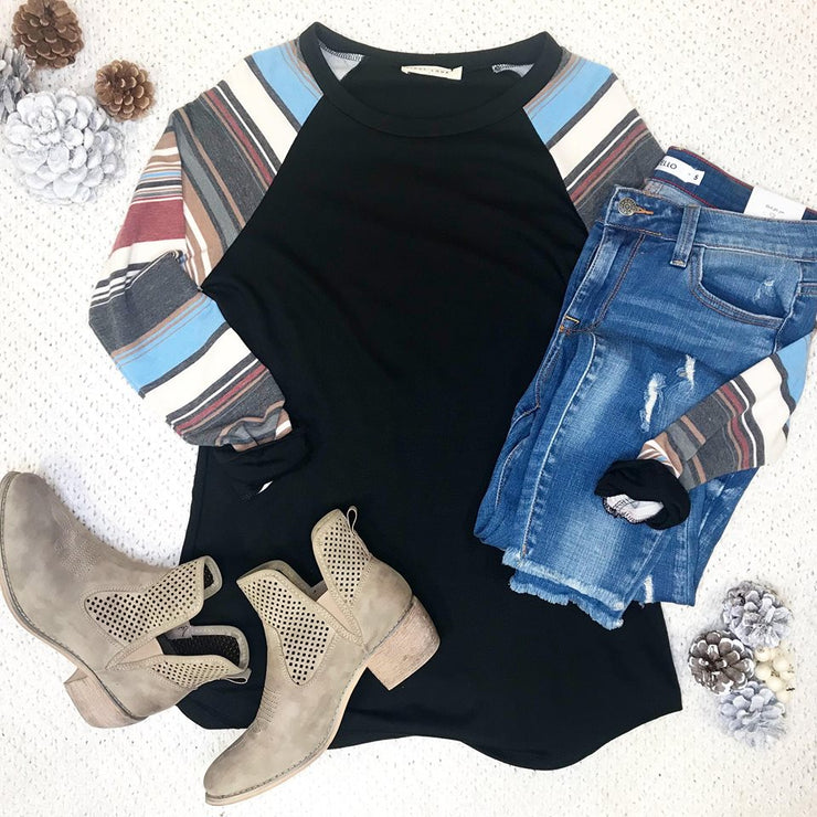 This black color block striped sleeve top is the perfect for that girl who loves to wear black tops!