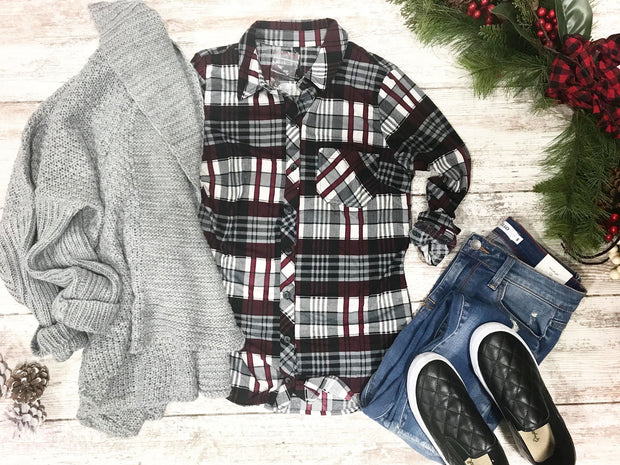 This plaid button up is the perfect blend of ivory, gray, black and burgundy.