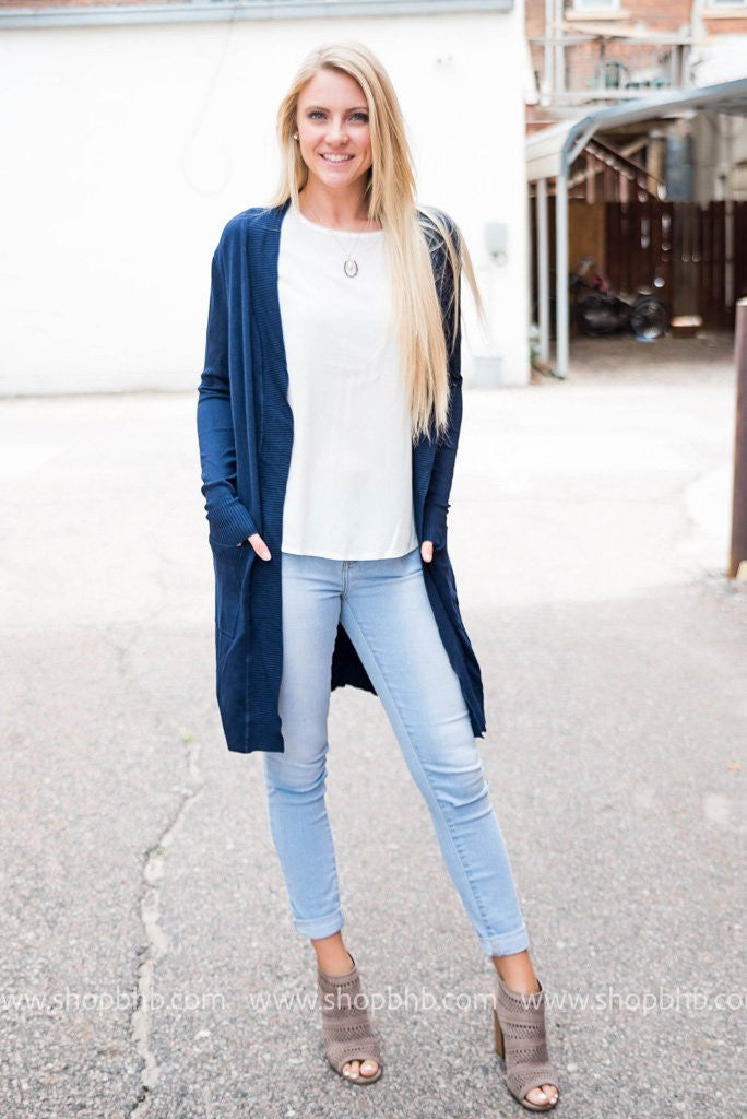 Navy long boyfriend cardigan worn with white tee and cuffed jeans