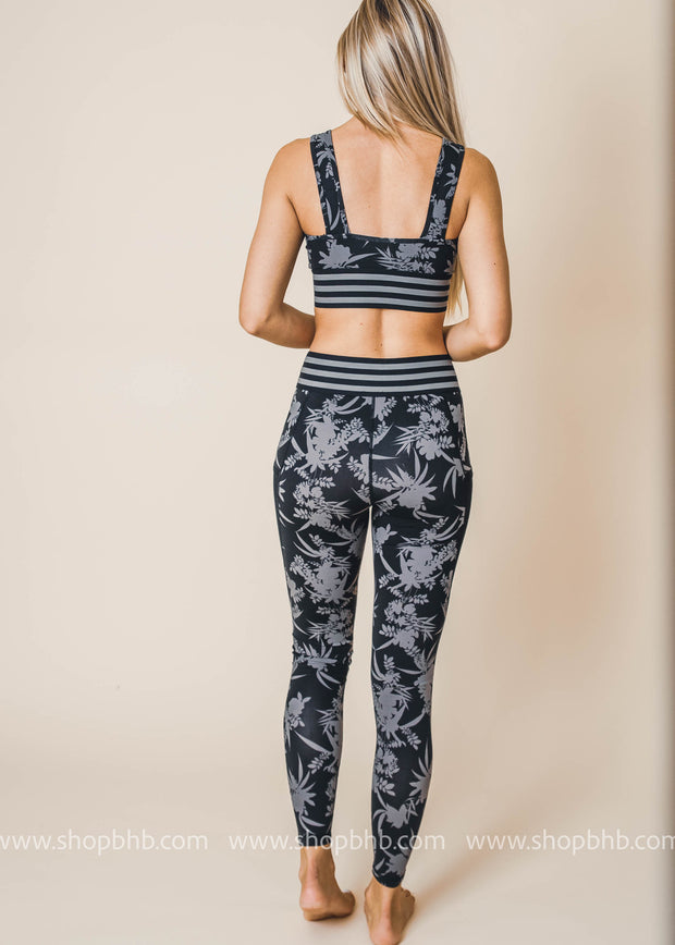striped band tropical silhouette print sports bra