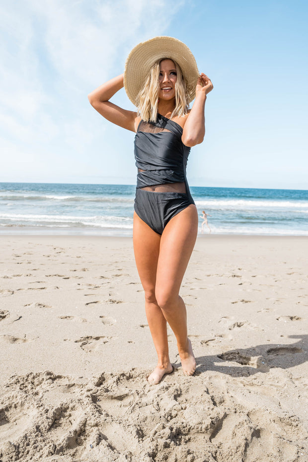 black swimsuit with ruching and mesh detailing