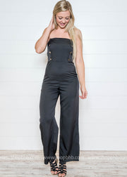 Loving this black double breasted jumpsuit...such a classic look for your holiday party style.