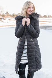 This black quilted winter coat runs the perfectly long length to keep your torso nice and warm.